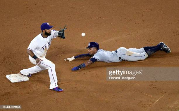 Elvis Andrus of the Texas Rangers gets the throw as Mallex Smith of the Tampa Bay Rays tries to steal second base in the fifth inning at Globe Life...