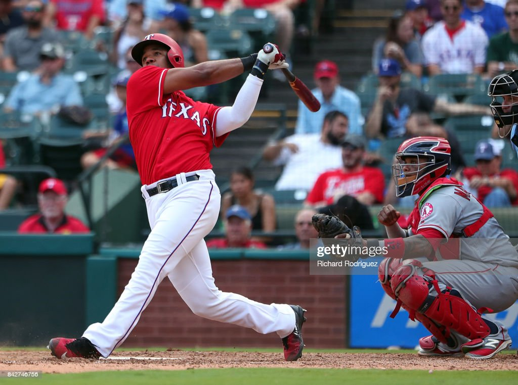 Elvis Andrus #1 of the Texas Rangers hits a home run against the Los Angeles Angels of Anaheim at Globe Life Park in Arlington on September 3, 2017 in Arlington, Texas.