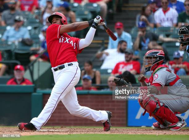 Elvis Andrus of the Texas Rangers hits a home run against the Los Angeles Angels of Anaheim at Globe Life Park in Arlington on September 3, 2017 in...
