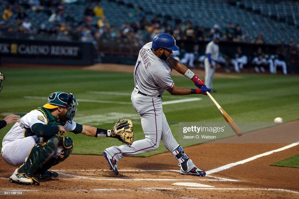 Elvis Andrus #1 of the Texas Rangers hits a single against the Oakland Athletics during the first inning at the Oakland Coliseum on April 2, 2018 in Oakland, California.