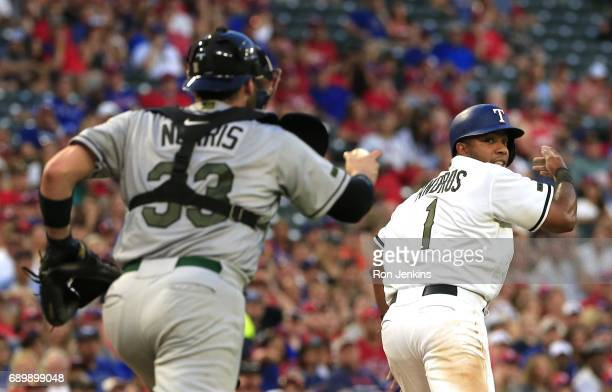 Elvis Andrus of the Texas Rangers is caught in a rundown as Derek Norris of the Tampa Bay Rays closes in for the out during the third inning at Globe...