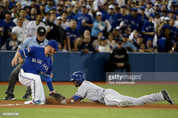 Elvis Andrus of the Texas Rangers is caught stealing on a tag by Josh Donaldson of the Toronto Blue Jays in the second inning in game five of the...