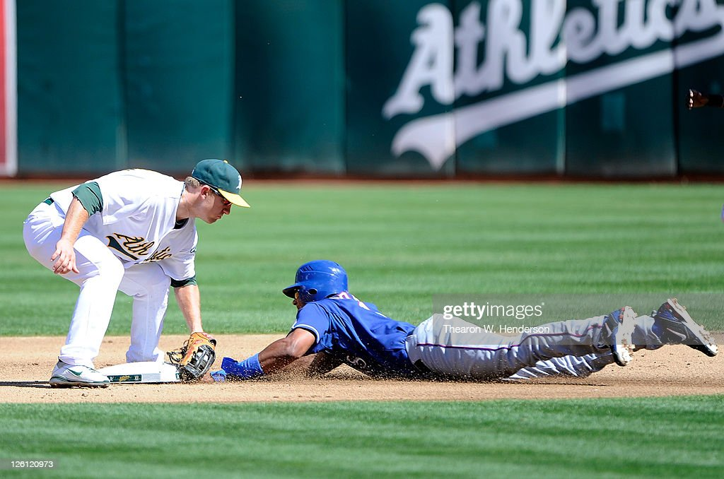 Elvis Andrus #1 of the Texas Rangers is caught stealing, tagged out at second base by Cliff Pennington #2 of the Oakland Athletics during an MLB baseball game at O.co Coliseum on September 22, 2011 in Oakland, California.
