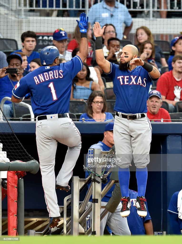 Elvis Andrus #1 of the Texas Rangers is congratulated by Roughned Odor #12 after hitting a first inning solo home run against the Atlanta Braves at SunTrust Park on September 4, 2017 in Atlanta, Georgia.