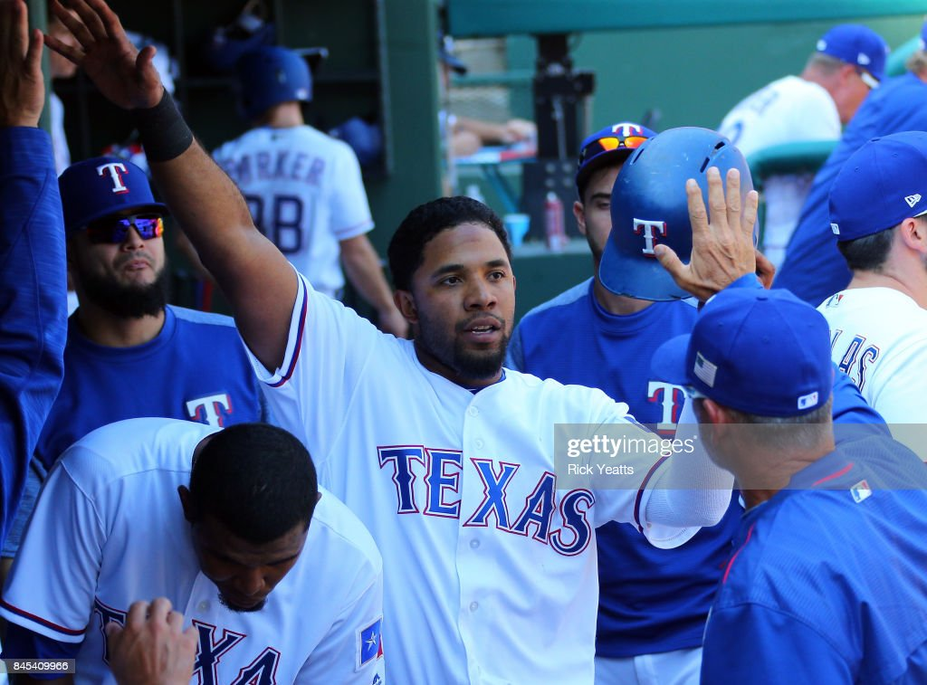 Elvis Andrus #1 of the Texas Rangers is congratulated for scoring in the fifth inning against the New York Yankees at Globe Life Park in Arlington on September 10, 2017 in Arlington, Texas.