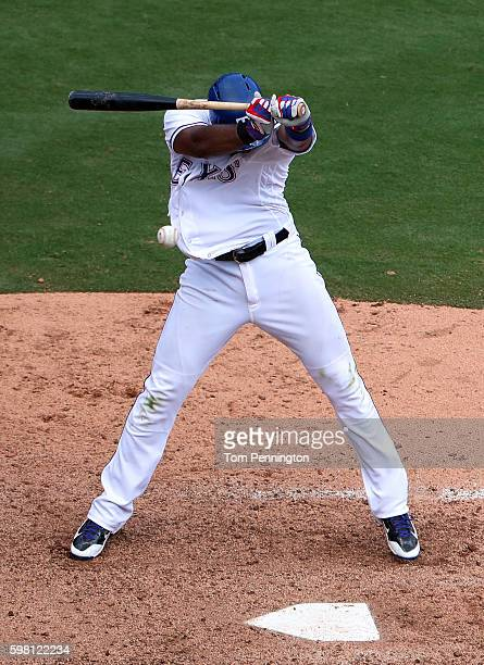Elvis Andrus of the Texas Rangers is hit by a pitch from Arquimedes Caminero of the Seattle Mariners in the bottom of the seventh inning at Globe...