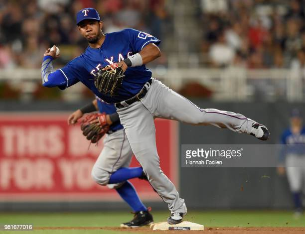 Elvis Andrus of the Texas Rangers makes a play at shortstop to get out Taylor Motter of the Minnesota Twins at first base during the seventh inning...