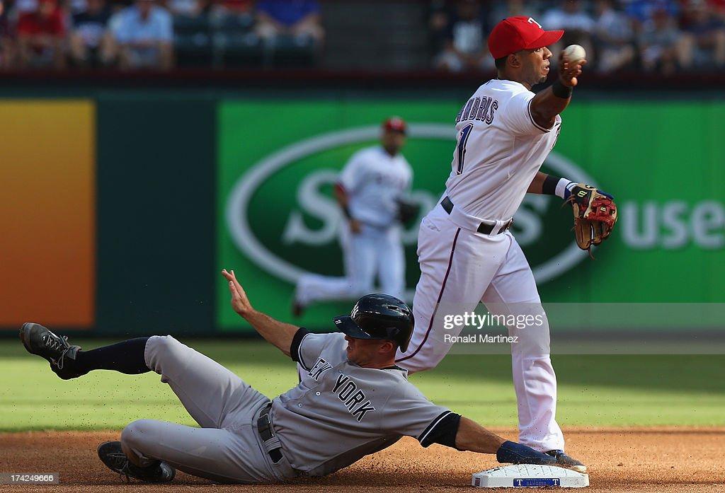 Elvis Andrus #1 of the Texas Rangers makes the out against Brett Gardner #11 of the New York Yankees at Rangers Ballpark in Arlington on July 22, 2013 in Arlington, Texas.