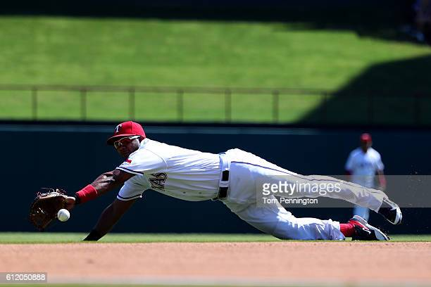 Elvis Andrus of the Texas Rangers misses fielding a ground ball single hit by Logan Forsythe of the Tampa Bay Rays in the top of the second inning at...
