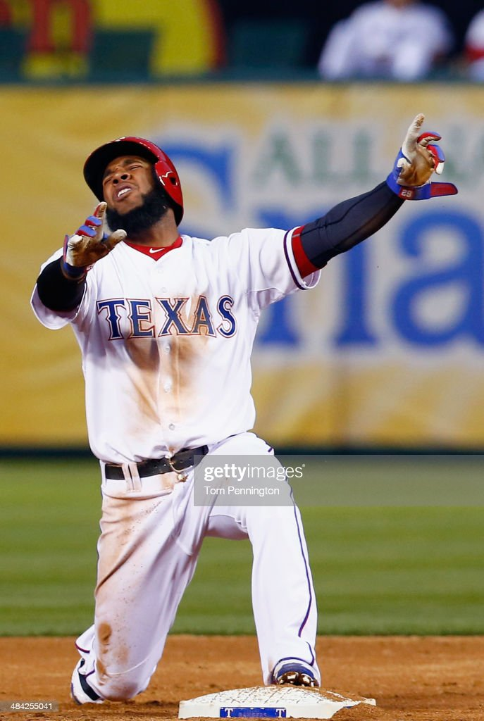 Elvis Andrus #1 of the Texas Rangers reacts after being tagged out while trying to steal second base against the Houston Astros in the bottom of the third inning at Globe Life Park in Arlington on April 11, 2014 in Arlington, Texas.