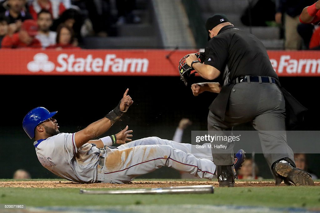 Elvis Andrus #1 of the Texas Rangers reacts to being called out by umpire Mark Carlson on a play at the plate during 4th inning of a baseball game between the Los Angeles Angels of Anaheim and Texas Rangers at Angel Stadium of Anaheim on April 9, 2016 in Anaheim, California.