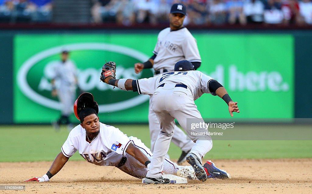 Elvis Andrus #1 of the Texas Rangers steals second base against Eduardo Nunez #26 of the New York Yankees at Rangers Ballpark in Arlington on July 22, 2013 in Arlington, Texas.