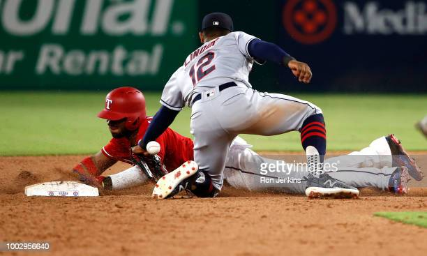 Elvis Andrus of the Texas Rangers steals second base as Francisco Lindor of the Cleveland Indians has the ball get by him during the sixth inning at...