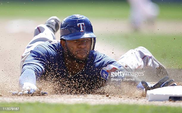 Elvis Andrus of the Texas Rangers steals third base in the sixth inning while playing the Detroit Tigers at Comerica Park on April 12 2011 in Detroit...