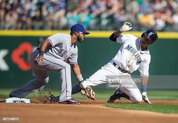 Elvis Andrus of the Texas Rangers tags out Ketel Marte of the Seattle Mariners on a steal attempt at second base during the first inning of a game at...