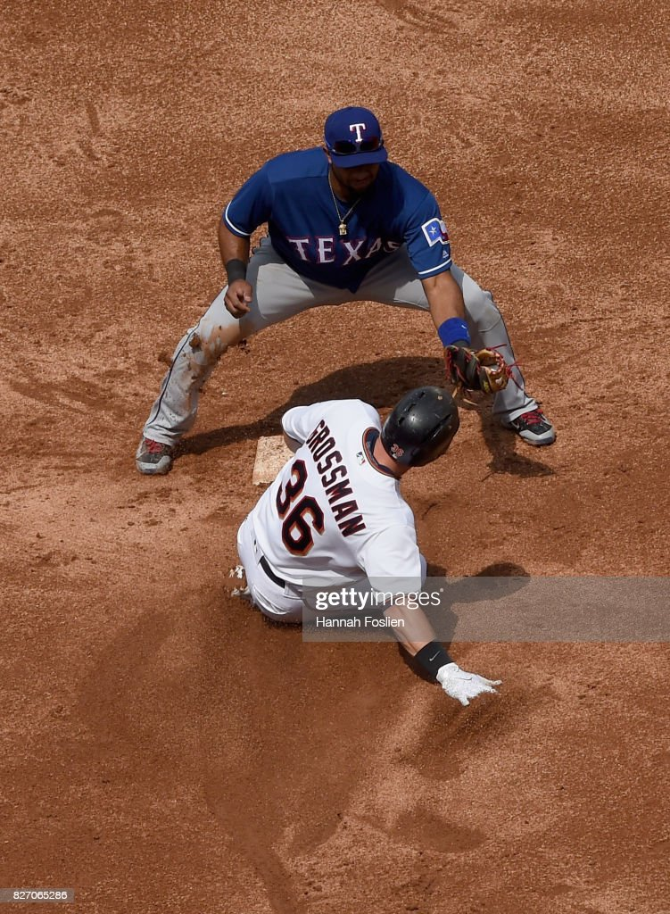 Elvis Andrus #1 of the Texas Rangers tags out Robbie Grossman #36 of the Minnesota Twins at second base after attempting to turn an RBI single into a double during the fifth inning of the game on August 6, 2017 at Target Field in Minneapolis, Minnesota. The Twins defeated the Rangers 6-5.