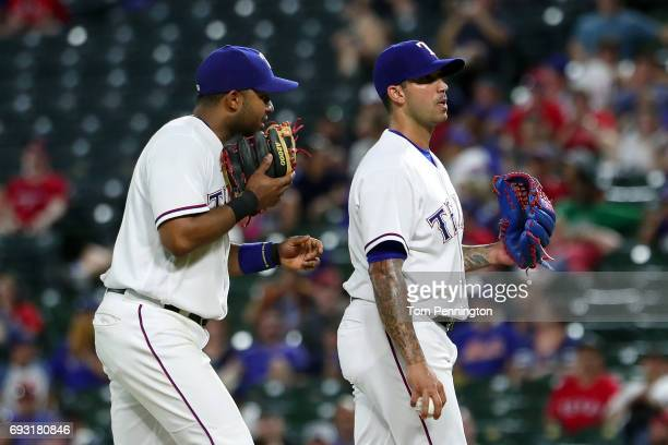 Elvis Andrus of the Texas Rangers talks with Matt Bush of the Texas Rangers on the mound against the New York Mets in the top of the ninth inning at...
