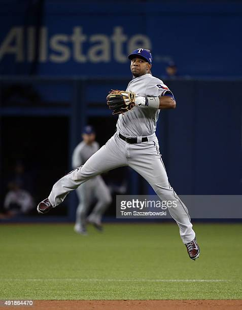 Elvis Andrus of the Texas Rangers throws out Justin Smoak of the Toronto Blue Jays in the second inning during game one of the American League...