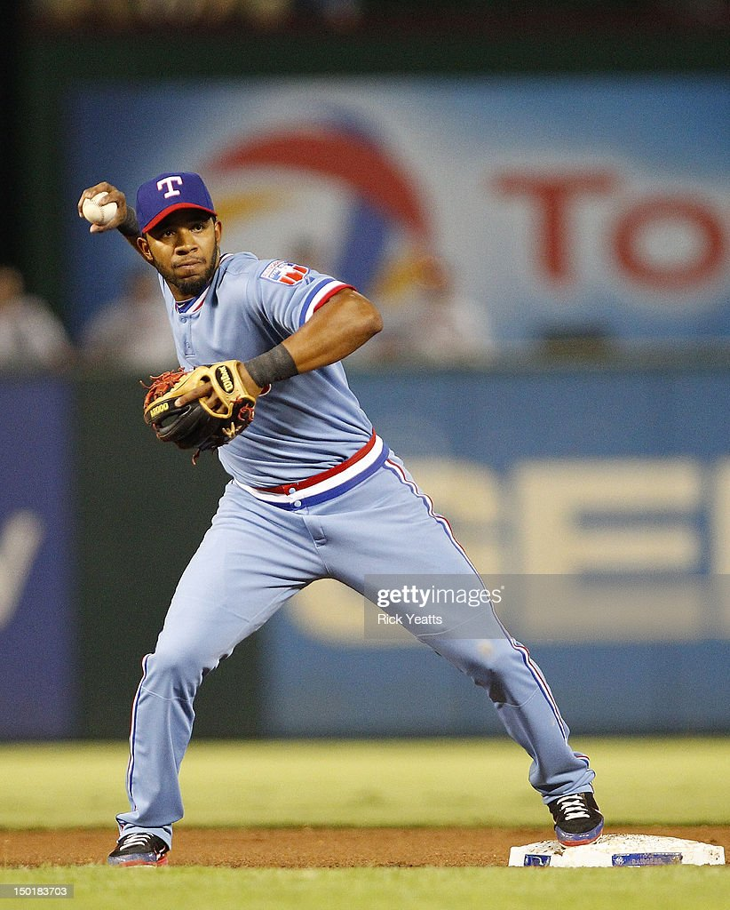 Elvis Andrus #1 of the Texas Rangers throws to first base against the Detroit Tigers at Rangers Ballpark in Arlington on August 11, 2012 in Arlington, Texas.