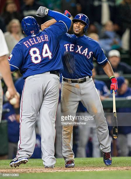 Elvis Andrus right of the Texas Rangers congratulates teammate Prince Fielder of the Texas Rangers after fielder hit a sholo home run off of relief...