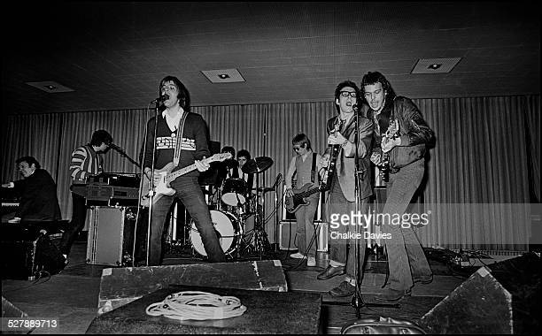 Elvis Costello and Martin Belmont from The Rumour sing backing vocals as Nick Lowe sings 'Heart of the City' at a soundcheck at Buffalo University,...