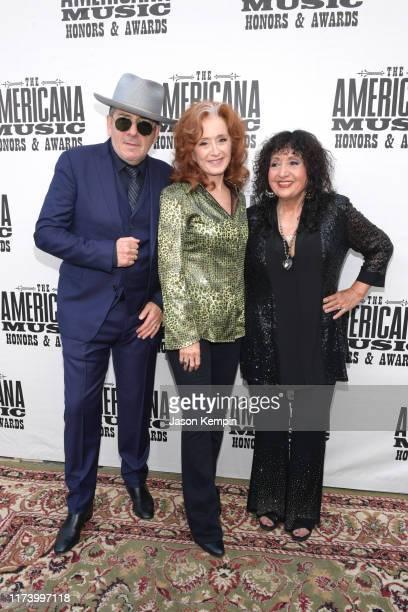 Elvis Costello Bonnie Raitt and Maria Muldaur attend the 2019 Americana Honors Awards at Ryman Auditorium on September 11 2019 in Nashville Tennessee