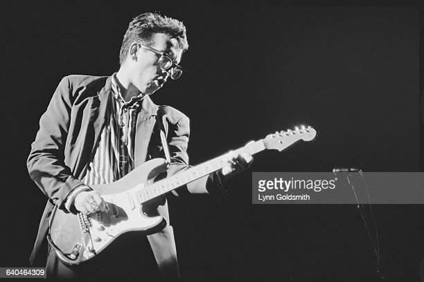 Elvis Costello Playing His Guitar