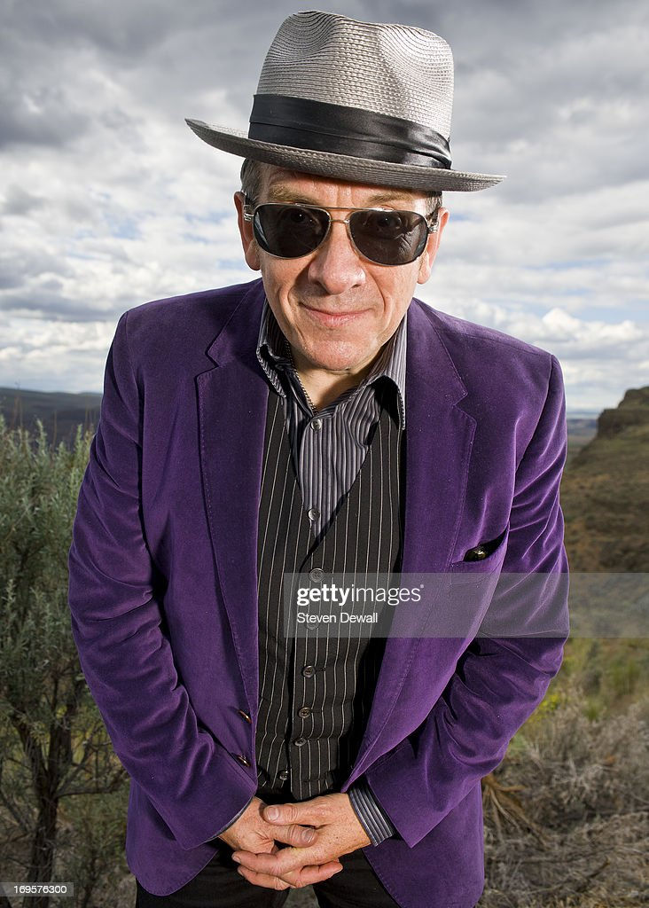 Elvis Costello poses for a portrait backstage at the Gorge Amphitheater on May 26, 2013 in Quincy, Washington.