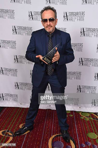 Elvis Costello poses with award during Songwriters Hall Of Fame 47th Annual Induction And Awards at Marriott Marquis Hotel on June 9 2016 in New York...