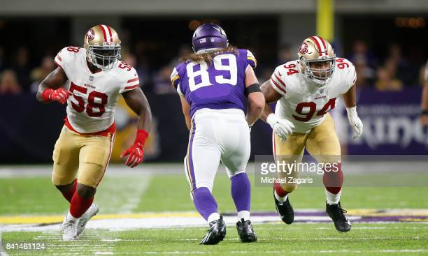 Elvis Dumervil and Solomon Thomas of the San Francisco 49ers rush the quarterback during the game against the Minnesota Vikings at US Bank Stadium on...