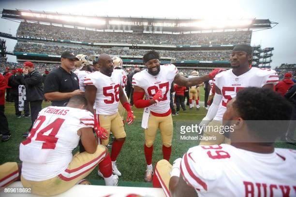 Elvis Dumervil Dekoda Watson and Eli Harold of the San Francisco 49ers talk on the sideline during the game against the Philadelphia Eagles at...