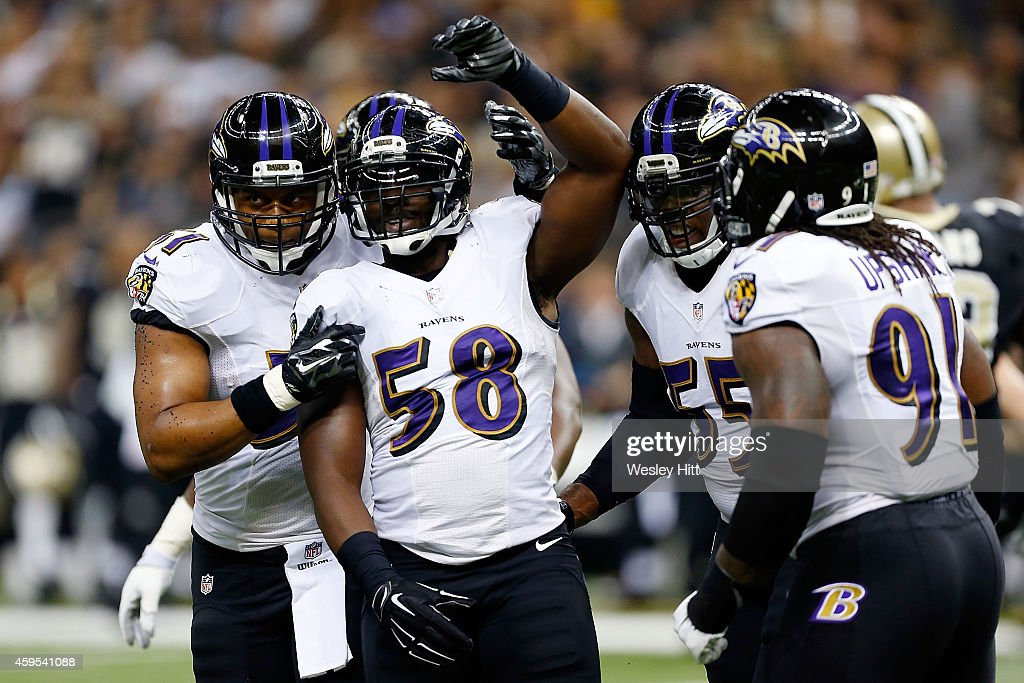 Elvis Dumervil #58 of the Baltimore Ravens celebrates a sack against the New Orleans Saints during the second quarter of a game at the Mercedes-Benz Superdome on November 24, 2014 in New Orleans, Louisiana.