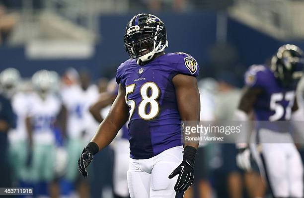 Elvis Dumervil of the Baltimore Ravens reacts against the Dallas Cowboys in the first half of the preseason game at ATT Stadium on August 16 2014 in...