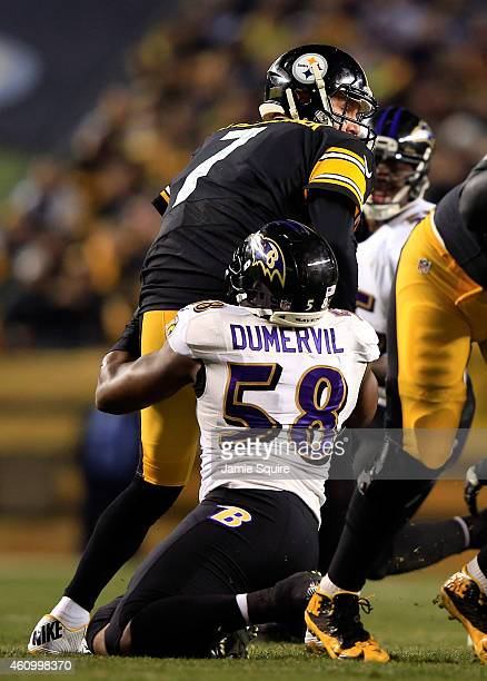 Elvis Dumervil of the Baltimore Ravens sacks Ben Roethlisberger of the Pittsburgh Steelers in the first quarter during their AFC Wild Card game at...