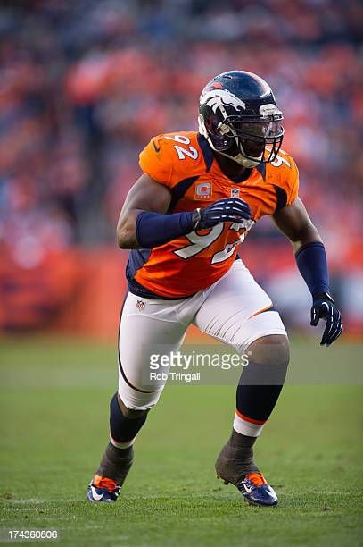 Elvis Dumervil of the Denver Broncos looks on during the game against the Tampa Bay Buccaneers at Sports Authority Stadium on December 2 2012 in...