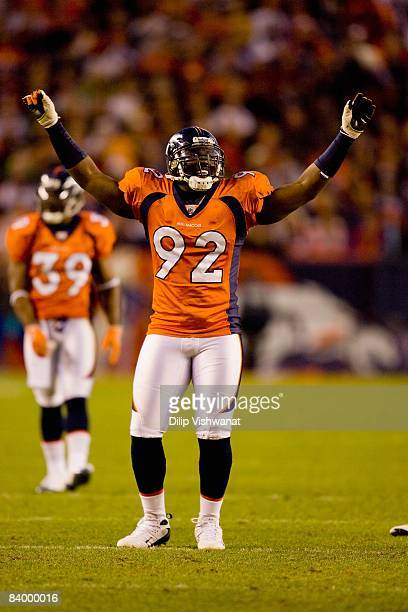 Elvis Dumervil of the Denver Broncos pumps up the crowd against the Kansas City Chiefs at Invesco Field at Mile High on December 7, 2008 in Denver,...