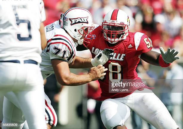 Elvis Dumervil of the Louisville Cardinals tries to get to Danny Embick the qarterback of the Florida Atlantic Owls during the game at Papa John's...