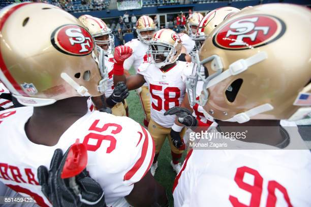 Elvis Dumervil of the San Francisco 49ers fires up the defense on the field prior to the game against the Seattle Seahawks at CenturyLink Field on...