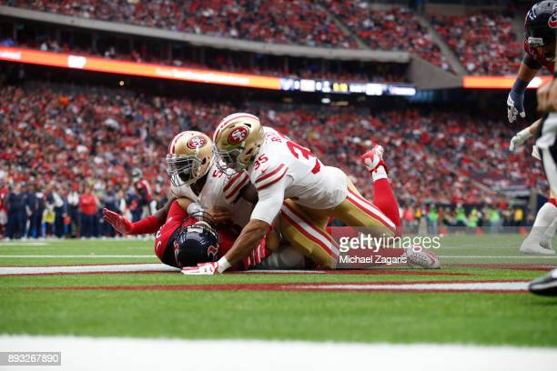 Elvis Dumervil of the San Francisco 49ers hits Tom Savage of the Houston Texans during the game at NRG Stadium on December 10 2017 in Houston Texas...