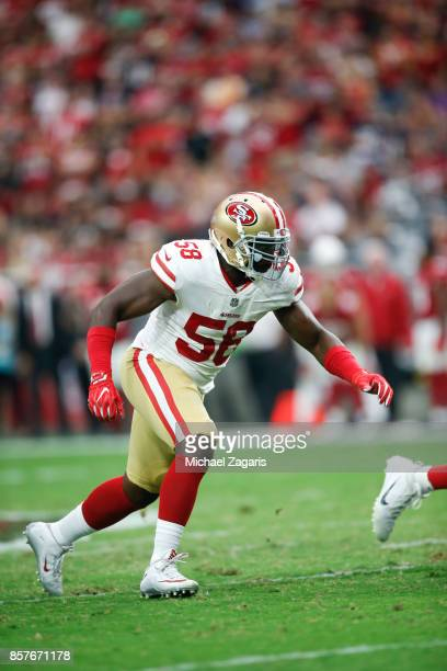 Elvis Dumervil of the San Francisco 49ers rushes the quarterback during the game against the Arizona Cardinals at the University of Phoenix Stadium...