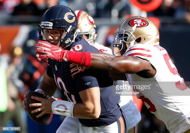 Elvis Dumervil of the San Francisco 49ers sacks quarterback Mitchell Trubisky of the Chicago Bears in the first quarter at Soldier Field on December...