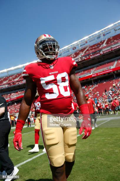 Elvis Dumervil of the San Francisco 49ers stands on the field prior to the game against the Carolina Panthers at Levi's Stadium on September 10 2017...