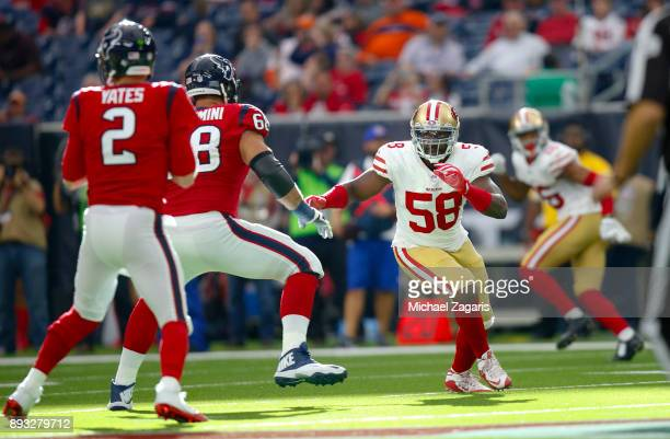 Elvis Dumervil the San Francisco 49ers rusehes the quarterback during the game against the Houston Texans at NRG Stadium on December 10 2017 in...