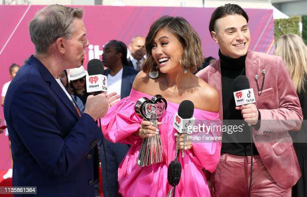 Elvis Duran Agnez Mo and Nick Tangorra attend the 2019 iHeartRadio Music Awards which broadcasted live on FOX at Microsoft Theater on March 14 2019...