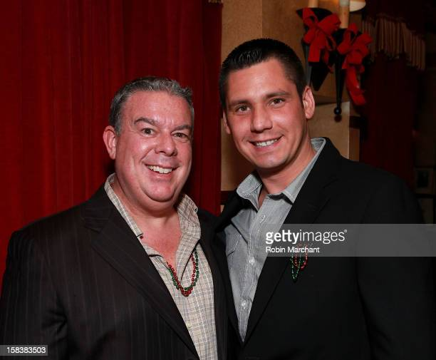 Elvis Duran and Alex Carr attend Elvis Duran Morning Show Holiday Party at Carmine's on December 14 2012 in New York City