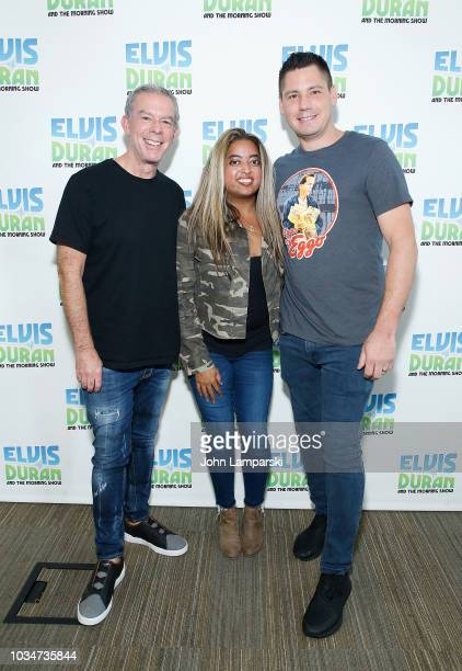 Elvis Duran and Alex Carr pose with Cohost Medha Gandh i as she joins The Elvis Duran Z100 Morning Show at Z100 Studio on September 17 2018 in New...
