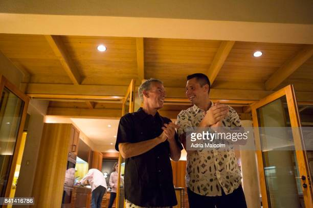 Elvis Duran and Alex Carr talk to guests at The Burning of Zozobra Preevent Dinner hosted by the Elvis Duran at his new home in honor of Mayor Javier...