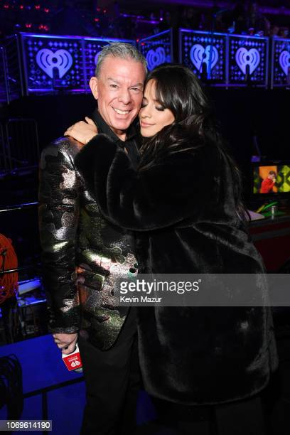 Elvis Duran and Camila Cabello pose backstage at Z100's Jingle Ball 2018 at Madison Square Garden on December 7 2018 in New York City