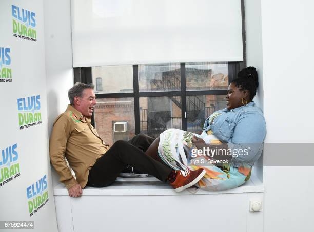 Elvis Duran and Gabourey Sidibe pose during 'The Elvis Duran Z100 Morning Show' at Z100 Studio on May 2 2017 in New York City