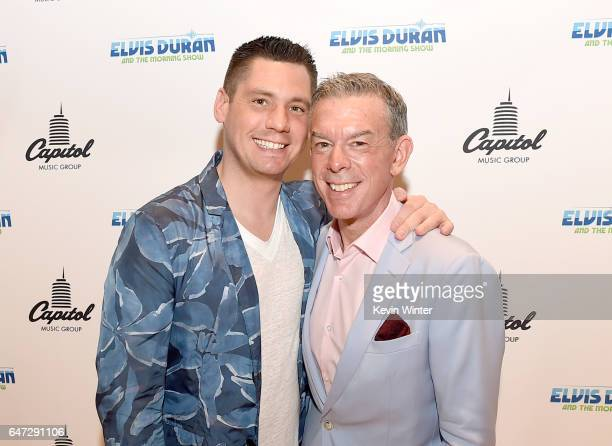 Elvis Duran and his partner Alex Carr pose at a reception celebrating radio personality Elvis Duran's star on the Hollywood Walk of Fame at Capitol...